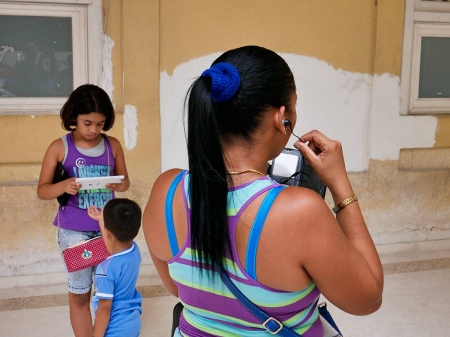 a cuban family connected to internet in havana, a photo essay by louis alarcon